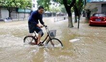 ВКитае изпострадавших отливней районов эвакуировали 1,5тысячи человек