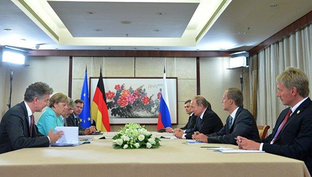 Путин иМеркель обсудили Минские соглашения иситуацию вСирии