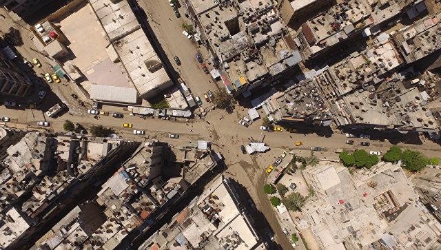 Безоружные боевики начали покидать восточную часть Алеппо