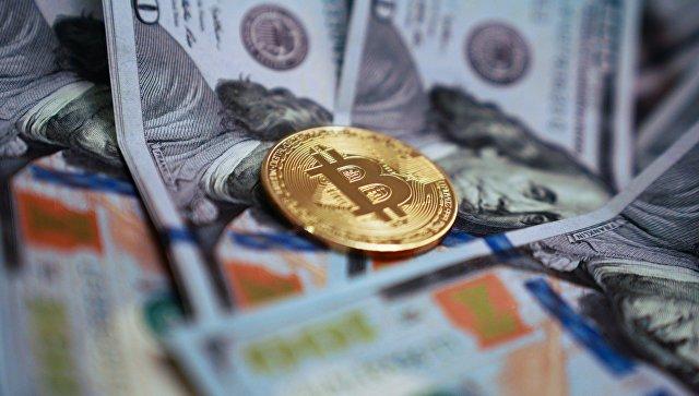 Курс биткоина упал ниже 7 тысяч долларов