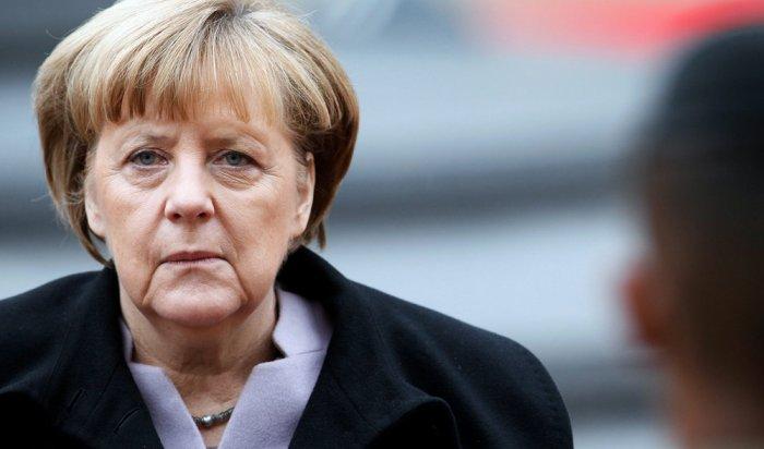 Неизвестный напал на канцлера ФРГ Ангелу Меркель